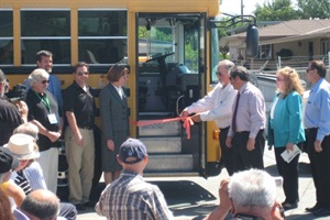 Gilroy Unified School District officials, clean-air advocates and other dignitaries gathered at the district's transportation facility to kick off a pilot project for an electric bus.