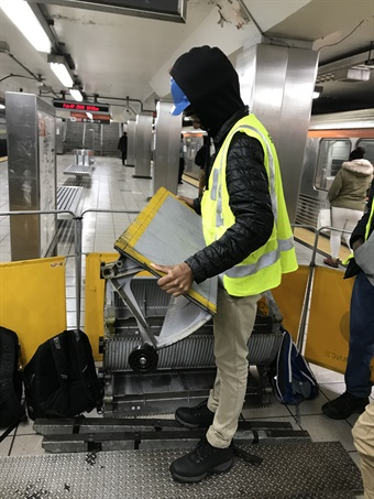 Abdul-Zahir Duncan, inspecting an escalator step assembly at SEPTA's Oregon Broad Street Line station. SEPTA