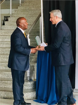 JTA CEO Nathaniel Ford Sr. receives the Thought Leader Award from Eno Center for Transportation CEO Robert Puentes.