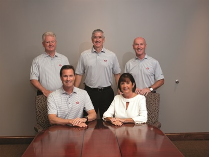 McCarthy Tire Service is led by family and a tight-knit executive team. Back row, from left: Neil Horn, vice president of operations, Joe Doyle, chief operating officer, and Gary Lambert Sr., vice president. Front row is siblings John McCarthy Jr., president, and Katie McCarthy Lambert, chief financial officer. All but Doyle have been with the company since the 1980s and they've watched their workforce grow to more than 1,300 people. (Photo by Michael Touey, Halibut Blue LLC)