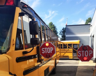 The Indiana attorney general released an opinion that states that regulations do not place a limit on the length of school bus stop arms. Shown here is an extended stop arm that was used in a pilot at a Virginia district in 2018. Photo courtesyAlbemarle County (Va.) Public Schools
