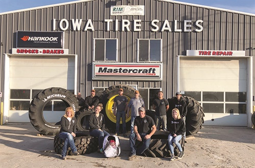 The employees of family-owned Iowa Tire Sales are (front, left to right): Betty Howard, owner, bookkeeper; Kassie Howard, office manager; Scarlett, helper and granddaughter; Jeremy Howard, owner; Sydney Howard, front desk manager; (back, left to right): Gary Reneker, service technician; John Mineart, alignment technician; Corbin Kissling, tire technician; Jeff Thomas, tire technician; Austin Gire, ag tire technician; and Tyler Krumboltz, tire technician.