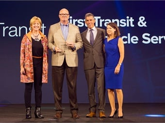 First Transit's Todd Hawkins accepts the 2016 Infor Excellence in Action Award in New York, New York, Monday, July 11, 2016. From left: Mary Trick, chief customer officer, Infor; Todd Hawkins, senior VP, First Transit; Duncan Angove, president, Infor and Pam Murphy, COO, Infor. (Photo: John McGall via Infor)