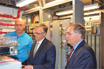 FRA Administrator Joseph Szabo and Siemens Freight & Rail Products CEO Kevin Riddett view rail automation technology engineered and manufactured by Siemens Louisville plant for PATH project in New York.