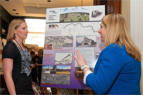 Two women discuss a project featured at the 2013 WTS Annual Conference in Philadelphia.