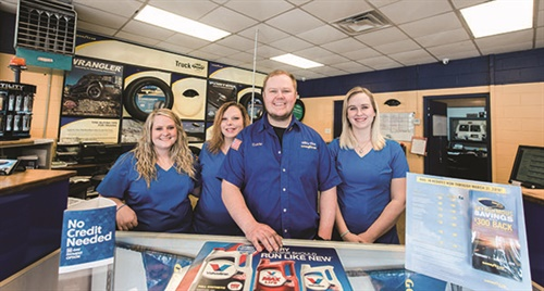 Currie Pierce co-owns Hill's Tire and Auto Service, which recently added no credit needed financing to its customer payment options. He is pictured with office employees (from left): Demi Parker, Gina Prince and Sam Babb.