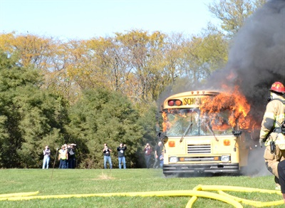 Firefighters and NAPT staff show how quickly a school bus can catch fire and how long evacuation can take in a demonstration that kicked off the association's annual conference.