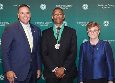 Darryl Hill (center), First Student's senior vice president of safety, was one of six individuals who received the National Safety Council's 2019 Distinguished Service to Safety Award. Photo courtesy First Student