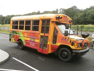 New Haven Public Schools will use a school bus donated by First Student to deliver free meals to thousands of students over the summer.