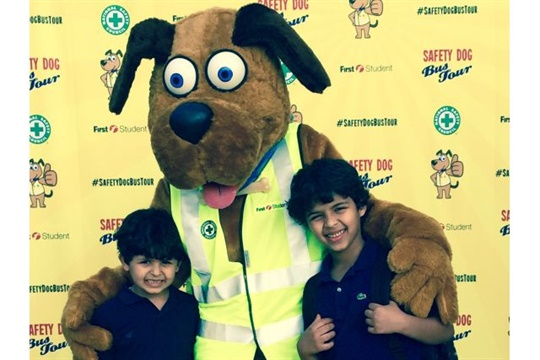 At First Student's Safety Dog Bus Tour stops, students can pose for a photo with Safety Dog and take part in interactive safety activities.