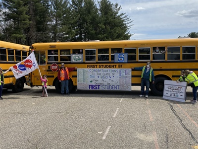 """In addition to placing buses in a """"2020"""" formation, a First Student location in New Hampshire made a banner to recognize all the routes and names of the drivers for all 36 bus routes, as well as signs to celebrate the seniors. Photo courtesy First Student"""