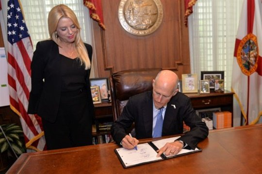 On Monday, Florida Gov. Rick Scott enacted a bill that targets stop-arm violators who cause serious injury or death. Scott is seen here signing a different bill earlier in June. Photo by Jesse Romimora