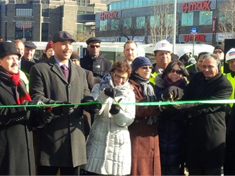 Officials, including FTA Acting Administrator Therese McMillan (center) celebrated the opening of Fordham Plaza earlier this week.