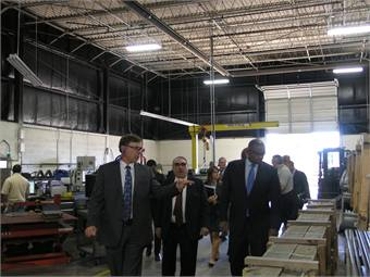 Jeff Wharton, president of IMPulse (shown left) gives Rep. Butterfield and Sec. Foxx a tour of the company's facility.