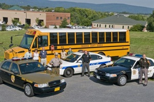 Frederick County (Md.) adopted a stop-arm camera ordinance in February. This photo, of officials from the school district's transportation department and three law enforcement agencies, was taken when legislation was initiated.