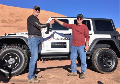 Mark Peak, left, takes the keys to a new Jeep from Robert Roller, vice president of sales for Friend Tire. Peak won the Jeep based on his Geolandar tire purchases.