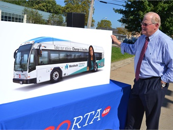 Greater Cleveland RTA CEO/GM Joe Calabrese checks out the rebranded vehicle imagery. Photo: GCRTA