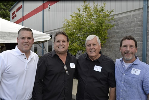 """""""We had 12 SKUs when we opened the door in 1979,"""" says Mike Hill, vice president of sales, wholesale (pictured, second from left), with, from left to right, Jeff Hill, retail sales manager; President Darrell Hill; and Pat Hill, vice president of service."""