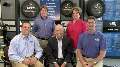 The late Mike Gatto, center, founded Gatto's Tires and Auto Service in 1970. (Photo courtesy of Gatto's Tires.)