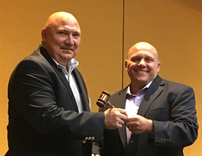 Tire Industry Association President Glen Nicholson (on right) passed the gavel to Incoming President Tom Formanek at TIA's annual meeting.