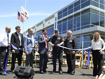 Gillig's longest-tenured employee did the ribbon cutting honors.