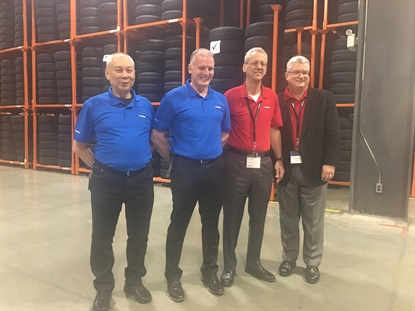 Giti officials gathered in the storage area of the company's South Carolina tire factory. From left, Phang Wai Yeen, Hank Eisenga, Tim Fulton and Jim Mayfield.