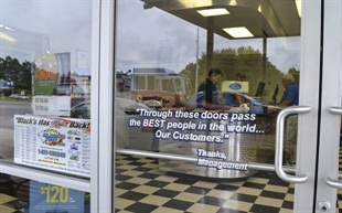 Black's Tire rallies its employees with yearly slogans, but this message is constant, and it adorns the front door of every store.