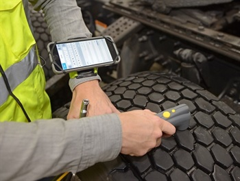 The scanning device electronically records air pressure and tread depth. The information automatically uploads via Bluetooth to a cloud-based platform. The Tire Optix app runs on the smartphone strapped to the wristband. Goodyear provides the wristband and scanning tool to a dealer using the software.