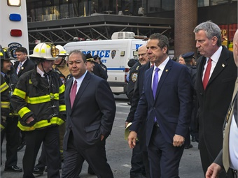 Governor Andrew M. Cuomo (Second from right), MTA Chairman Joseph Lhota and Mayor Bill de Blasio visit the scene and provide a media update after an improvised explosive device was detonated in a passageway of the 42 St-Port Authority station on Mon., December 11, 2017. Photo: Marc A. Hermann/MTA New York City Transit