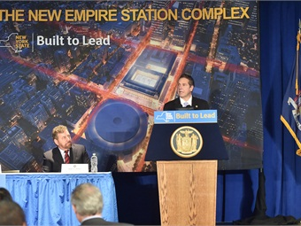 The Governor outlined his initiatives at an event Jan. 6, 2016 in Madison Square Garden, where he was joined by Madison Square Garden President James Dolan (seated), Amtrak President and CEO Joseph H. Boardman, and Empire Development Corporation President and CEO Howard Zemsky.(Kevin P. Coughlin/Office of the Governor)