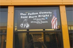 "The memorial decals reference the school slogan and mascot, ""We are the Comets,"" and are featured on the second windows of the buses."