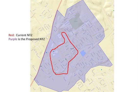"""This map shows the previous """"no transportation zone"""" (NTZ) for Jeffersonville High School outlined in red, with a larger area shaded in purple illustrating the new NTZ."""