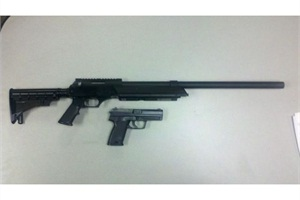 Two teens were taken into custody after firing these replica guns at a school bus.