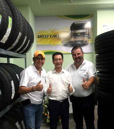 Guorong Ge (center) and two local dealers at a ceremony marking the opening of a Westlake store in Cancun, Mexico.
