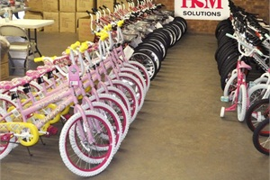 HSM employees and Hickory Fire Department volunteers helped assemble bikes on Dec. 4 at the HSM regional sales office in support of Bikes for Tykes. In total, 647 bikes were distributed at the Hickory American Legion Fairgrounds on Dec. 16 and 17.