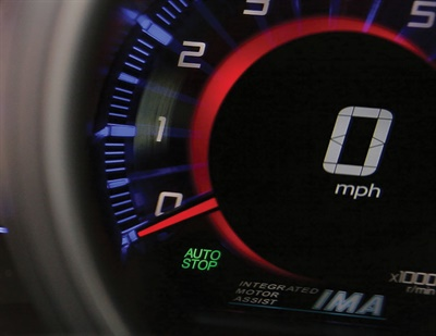 "After the driver has stopped the car, Honda's ""AUTO STOP"" light warns that the engine will start again once the brake pedal is released. In the auto industry, there is no standard design for this warning light; Toyota uses a ""READY"" icon, while Ford lights up a little picture of a car."