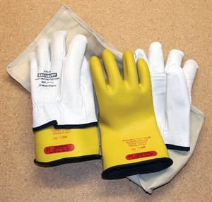 Lineman's gloves rated for 1,000 volts are used to disconnect/connect the high-voltage battery. The stamp shows this sample pair is out of date; the gloves should be tested twice a year at a certified testing lab. The leather over-gloves protect them from sharp edges. Also, they should be kept in a canvas bag when not in use.