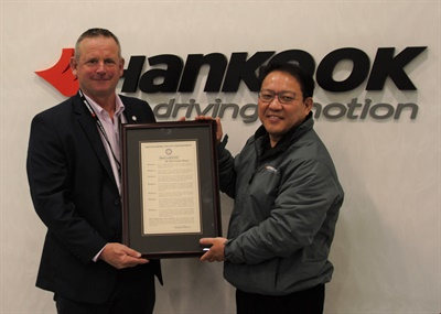 Montgomery County Tennesse Mayor Jim Durrett (left) presents a proclamation honoring Hankook to Ilhwan Jeon, president of the Hankook tire plant.