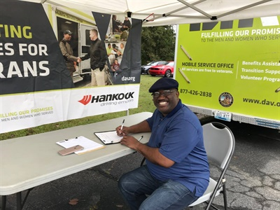 A U.S. military veteran pauses for a photo at the DAV's MSO stop at the NTW facility in Marietta, Ga.