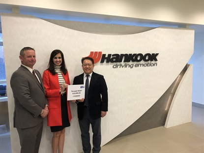 Hankook donated $10,000 to tornado victims in its new American hometown of Clarksville, Tenn. From left isMontgomery County Mayor Jim Durrett, United Way of the Greater Clarksville Region CEO Ginna Holleman, and Hankook Tire Tennessee Plant President Ilhwan Jeon.