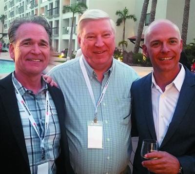 (From left to right) Dan King, Tire Warehouse Inc.; Gary Longerbeam, Monro Muffler Brake Inc.; and Shawn Denlein, Hankook Tire America Corp., enjoy the opening night reception.