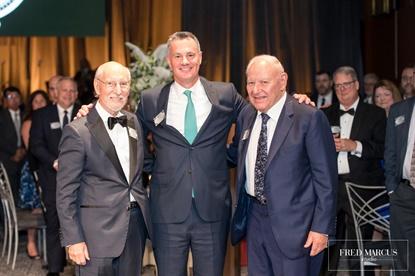 Goodyear's Rich Kramer presented brothers Harold Finkelstein and Jerry Finkelstein with Lifetime Achievement Awards.