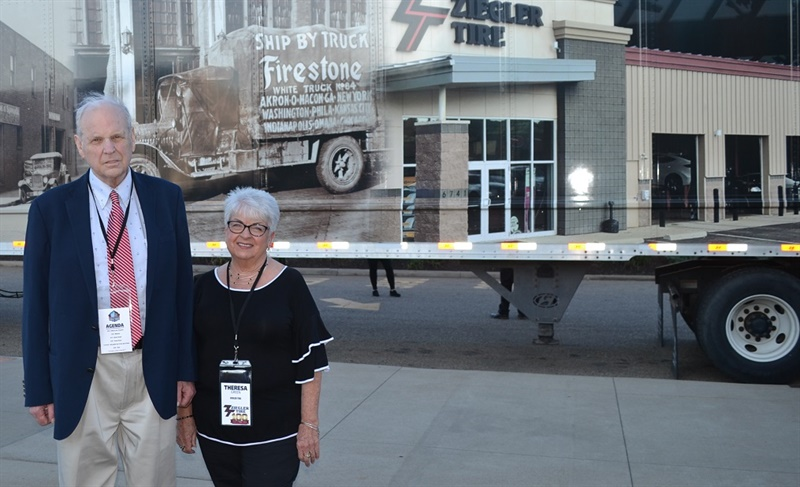 "Harold Jr. (left) is a second-generation Ziegler who joined the company in 1957. Theresa Green, corporate office accounts receivables manager, marked 50 years of service in January 2019. She says Harold ""still signs all the checks and opens the mail."" They are pictured at the company's 100th anniversary celebration at the Pro Football Hall of Fame in Canton, Ohio, in front of a truck wrapped in graphics highlighting the company's history."