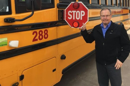 After a loaded logging truck failed to stop for one of his district's buses, Harry Davis of High Prairie School Division took a powerful safety message to the mill's contracted drivers.
