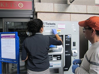 Researchers Regina Joice and Jose Vallarino swab subway ticket machines. Photo: Harvard T.H. Chan - School of Public Health