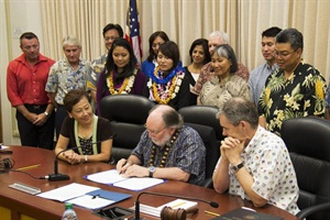 At the Hawaii State Board of Education's July 2 meeting, Gov. Neil Abercrombie signed two bills that are expected to help the state more efficiently manage its student transportation system.
