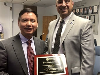 SacRT among agencies recognized with TSA's Gold Standard Award in 2019. TSA Federal Security Director Sid Hanna (right) presented the award to SacRT's GM/CEO Henry Li.