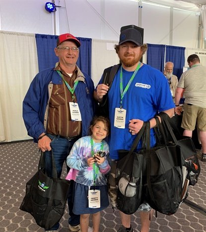 Three generations of the Gehrke family were collecting freebies from vendors during the Point S trade show to take back to the team at Hermiston Point S in Hermiston, Ore. From left, Merle, Austin, and Trinity.