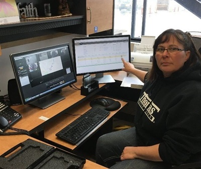 Diane Elliott, transportation supervisor for High Prairie School Division, reviews a driver-reported violation downloaded from the bus to the terminal.