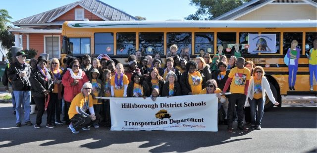 Here's a full view of the Hillsborough transportation team and their decorated bus, which is one of the district's new propane models.